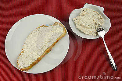 Bread of tuna spread on white plate and bowl
