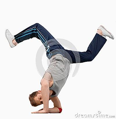 Break dancer doing a hand stand