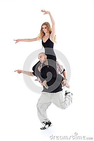 Breakdancer keeps on shoulders ballerina