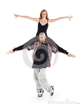Breakdancer keeps on shoulders ballerina and poses