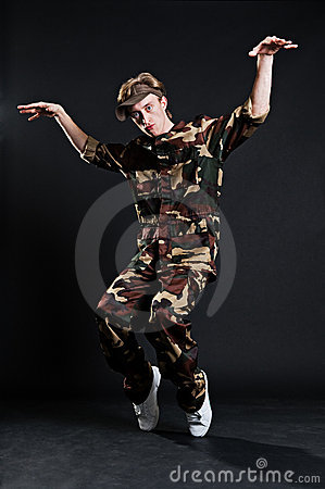 Breakdancer in military uniform