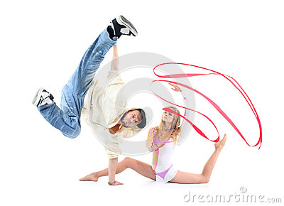 Breakdancer stands on hand and leg held up and gymnast