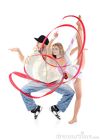 Breakdancer stands on tiptoe in profile and gymnast girl witn ribbon