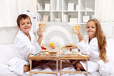 Breakfast in bed with happy kids