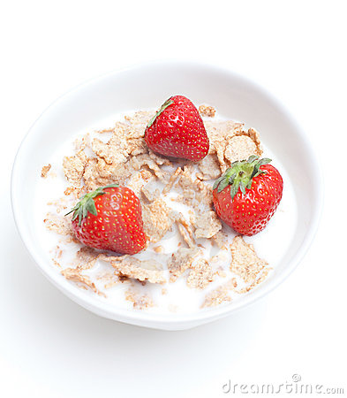 Breakfast cereal with milk and strawberries