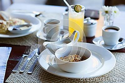 Breakfast with cereals, milk, fruit juice and coffee