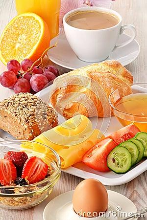 Breakfast with coffee, rolls, egg, orange juice