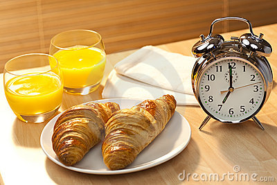 Breakfast Croissant, Orange Juice and Alarm Clock