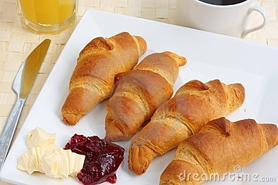 Breakfast of croissants, orange juice and coffee