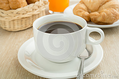Breakfast with cup of black coffee, breads and juice
