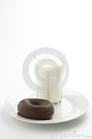 Breakfast glass of chocolate milk and donut
