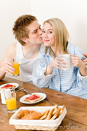 Breakfast happy couple enjoy romantic kiss