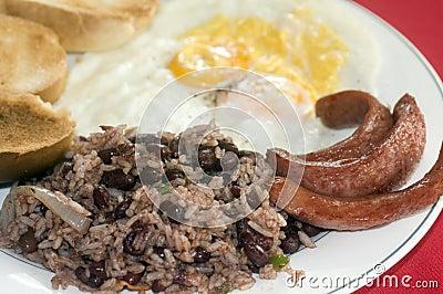 Breakfast in Nicaragua gallo pinto eggs sausage