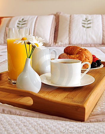 Free Breakfast On A Bed In A Hotel Room Stock Photography - 5182482