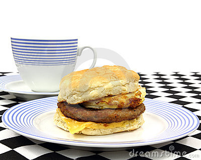 Breakfast sandwich on plate and coffee