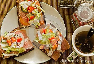 Breakfast sandwich and tea