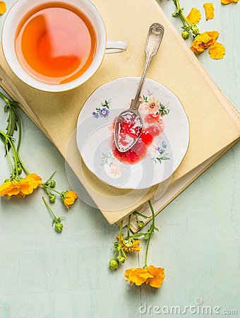 Free Breakfast Scene: Cup Of Tea, Plate With Red Jam And Vintage Spoon On A Book And Yellow Garden Flowers Stock Image - 55136931