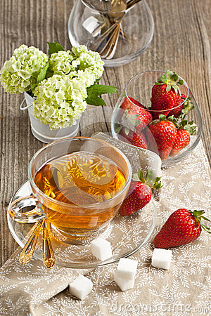 Breakfast with tea and strawberries