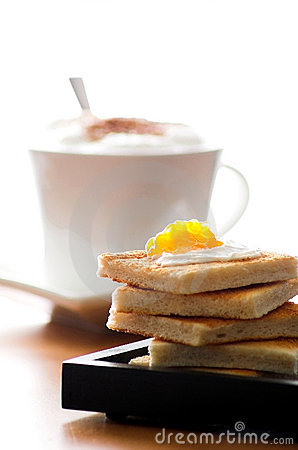 Breakfast toast with marmelade and coffee
