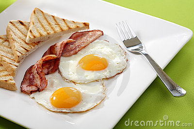 Breakfast - toasts, eggs, bacon