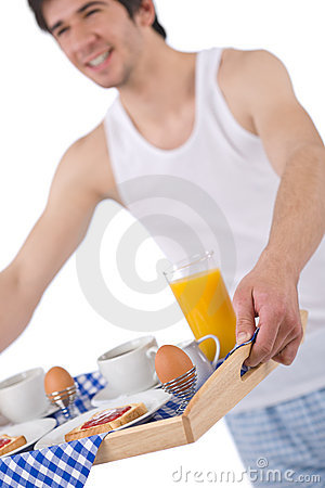 Breakfast - young man holding tray toast and juice