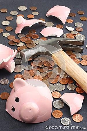 Breaking a piggy bank business & finance concept