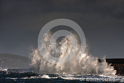 Breaking waves over Holyhead Breakwater