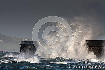 Breaking waves over Holyhead Breakwater