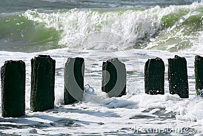 Breakwater and wavy ocean.