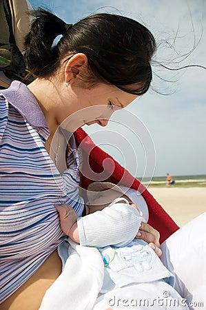 Breast feeding on the beach