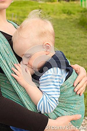 Breastfeeding in baby sling outdoors