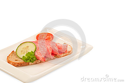 Bred with salami on plate