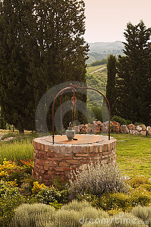 Brick-built well in tuscany garden