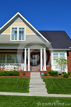 Free Brick Cape Cod House Royalty Free Stock Photography - 27098037