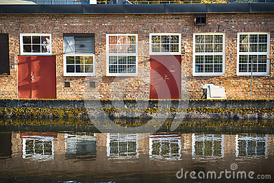 Brick facade by water
