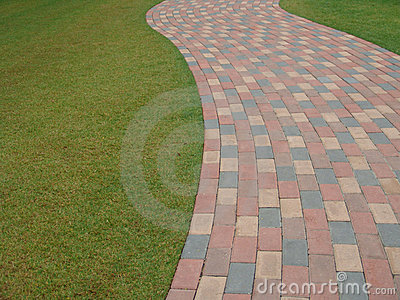 Brick footpath next to grass