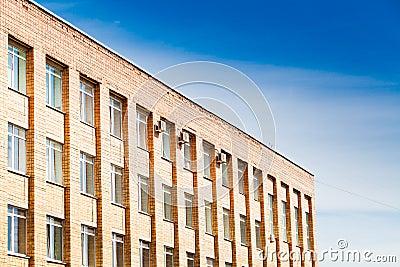 Brick office buildind under blue sky