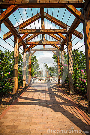 Free Brick Walkway Through Rose Arbor Toward Fountain Stock Images - 34840284