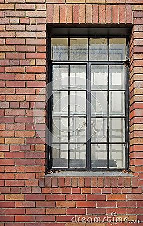 Brick wall black rimmed window