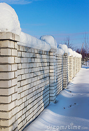 Brick wall, covered with snow in January