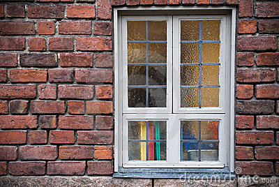 Brick wall with detailed office window
