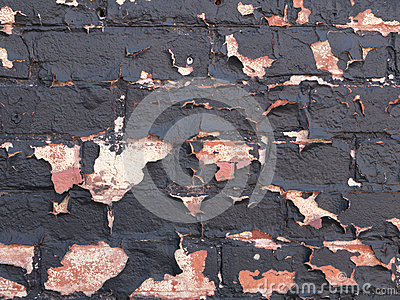 Brick wall peeling paint background or texture
