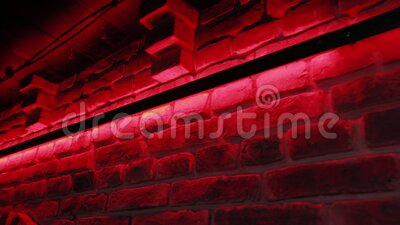 Brick wall with red light. Brick wall with red light stock video footage