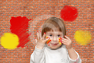 Brick wall. The soiled child
