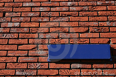 Brick wall with street sign