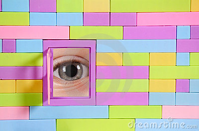 Brick wall with window and eye