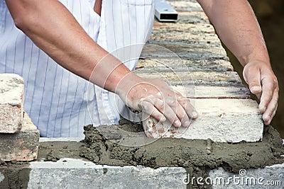 Bricklayer hands closeup