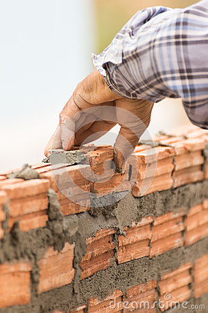 Free Bricklayer Working In Construction Site Of A Brick Wall Royalty Free Stock Photo - 51651415