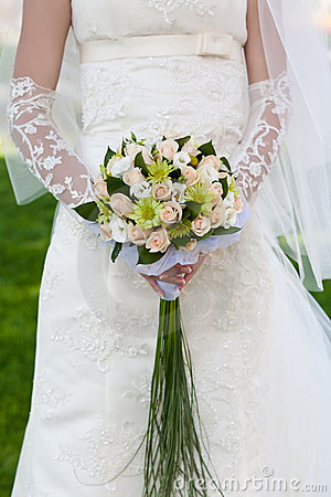 Bridal bouquet  in the the bride s hands