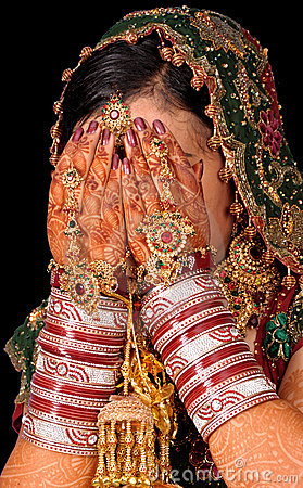 Bridal hands on face